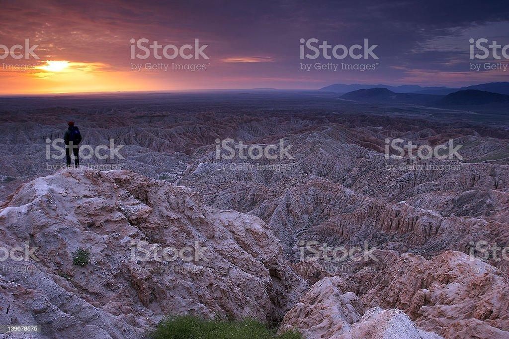 Hiker at sunrise stock photo