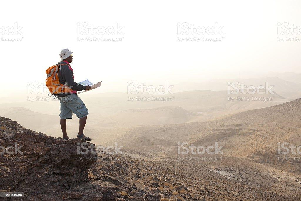 Hiker at sunrise. stock photo