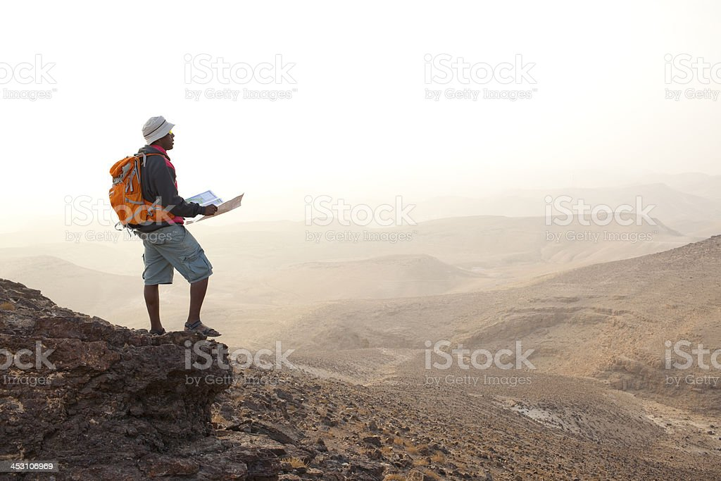Hiker at sunrise. stock photo