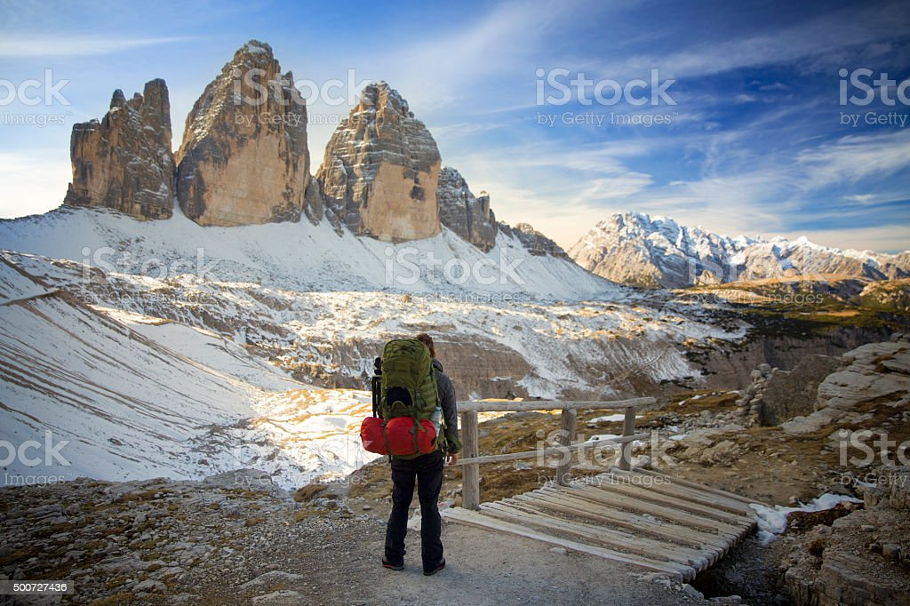 Hiker at the three pinnacles in the Dolomites stock photo