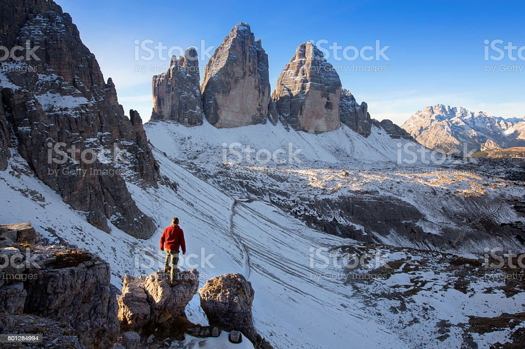 Hiker at the Three pinnacles in the eastern Dolomites stock photo