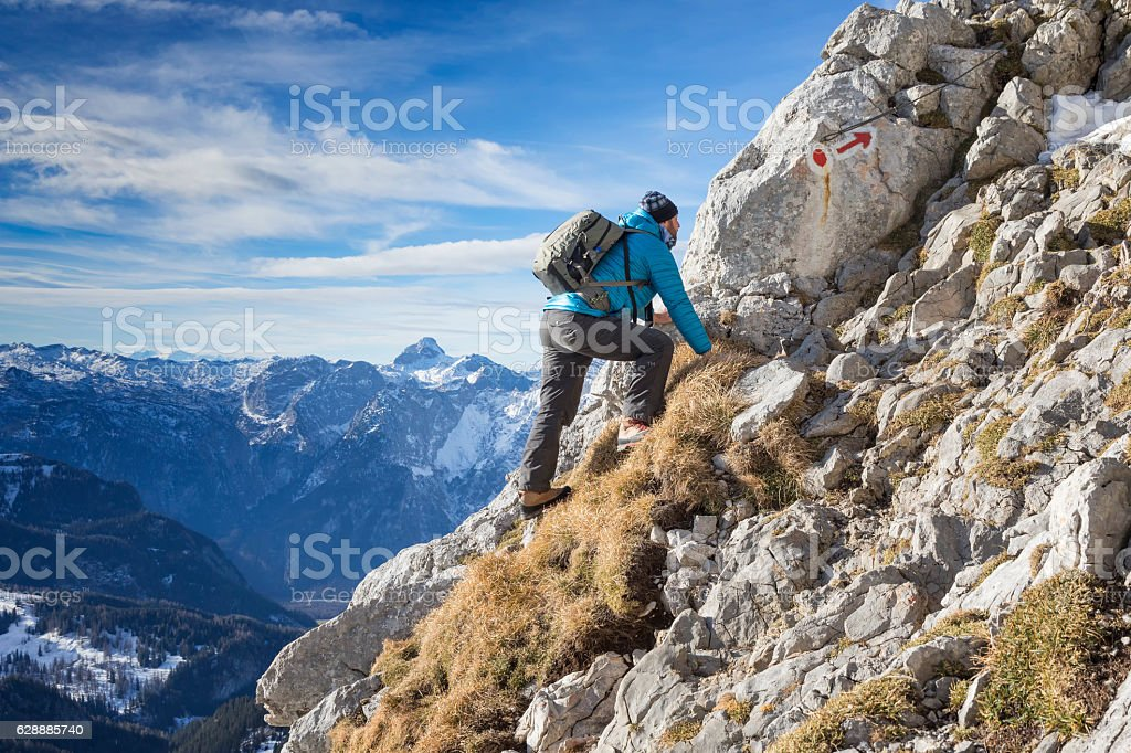 Hiker at the way to summit Hoher Göll - Alps stock photo