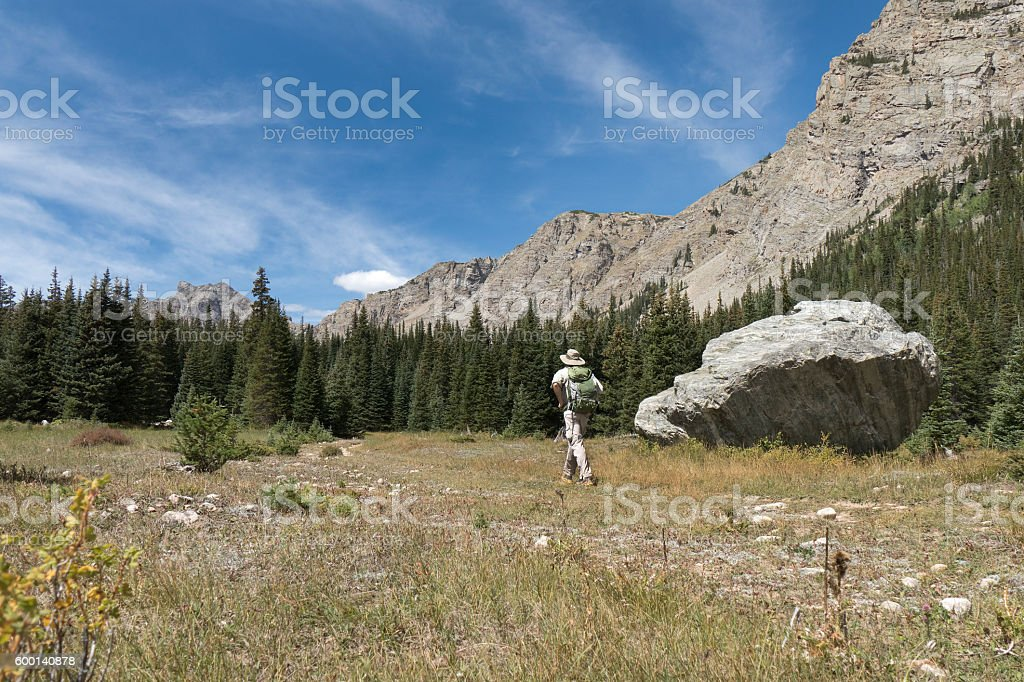 Hiker backpacker man hiking Indian Peaks Wilderness Rocky Mountains Colorado stock photo