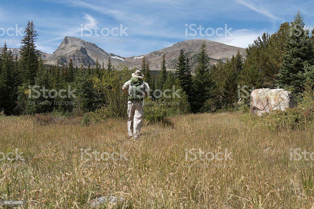 Hiker backpacker man hiking Indian Peaks Wilderness Sawtooth Mountain Colorado stock photo