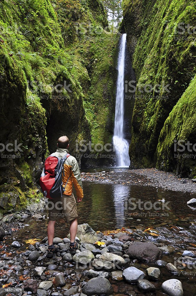 Hiker by Waterfall royalty-free stock photo