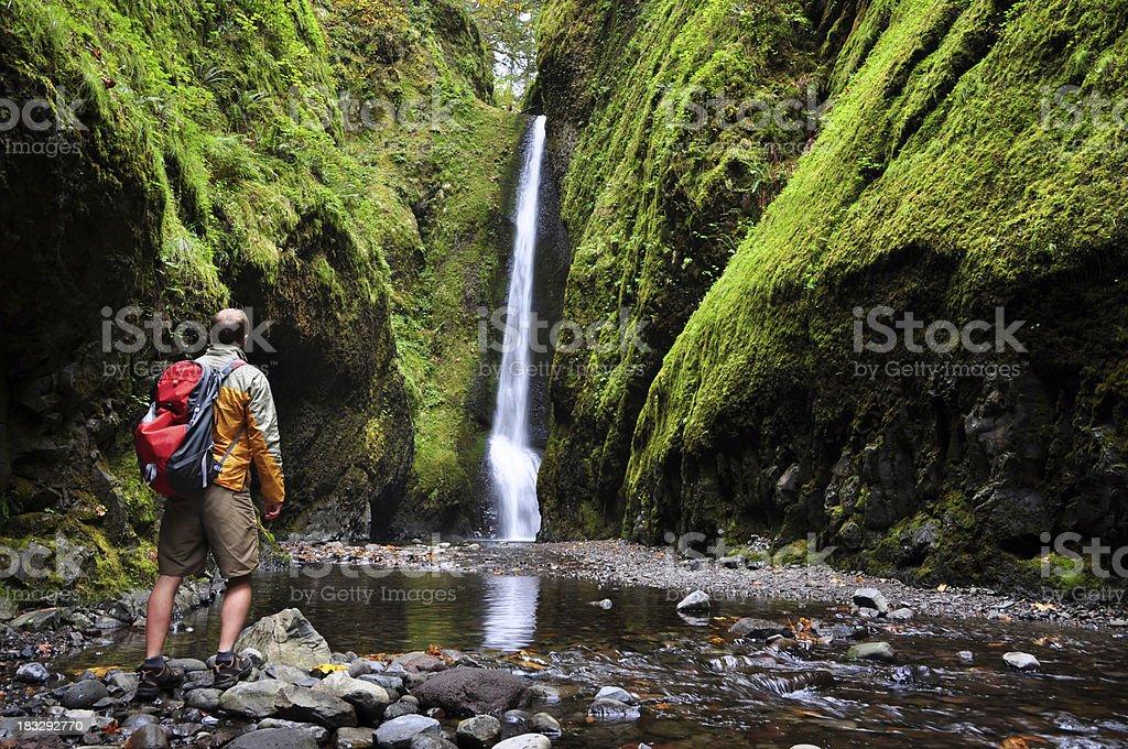 Hiker by Waterfall stock photo