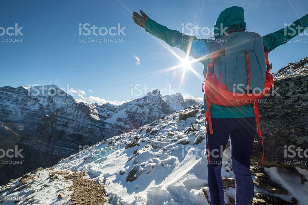 Hiker celebrating on mountain top stock photo