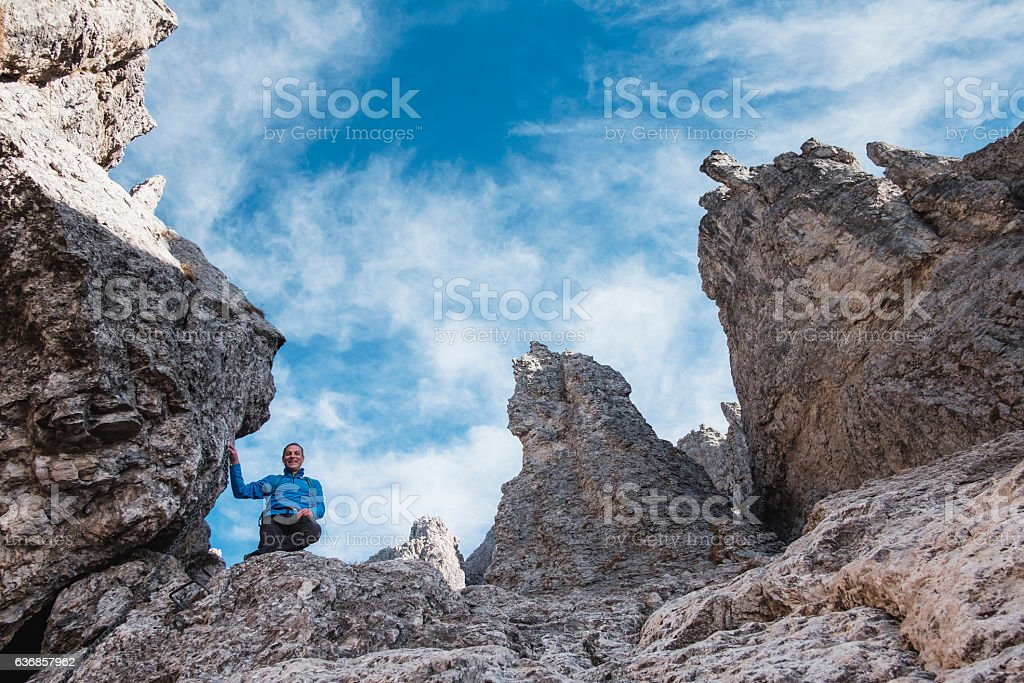 Hiker climb mountain on equipped trail stock photo