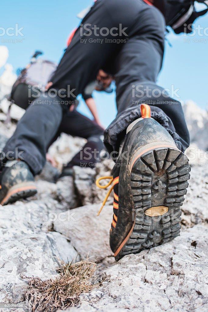 Hiker climbing stock photo