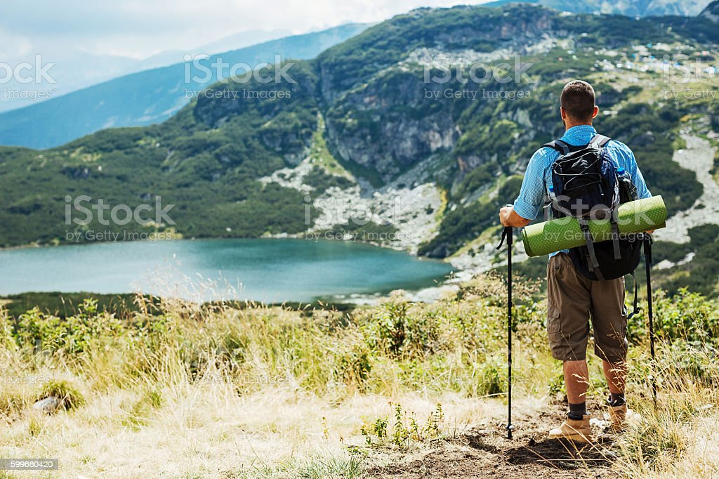 Hiker contempating the scenery stock photo