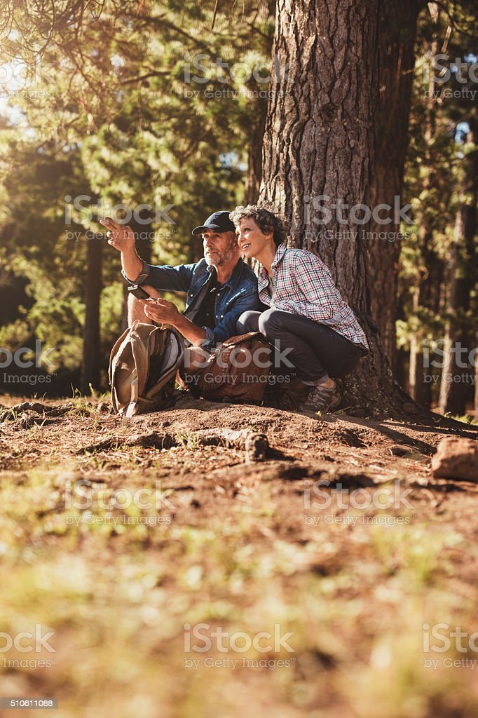 Hiker couple finding the right way stock photo