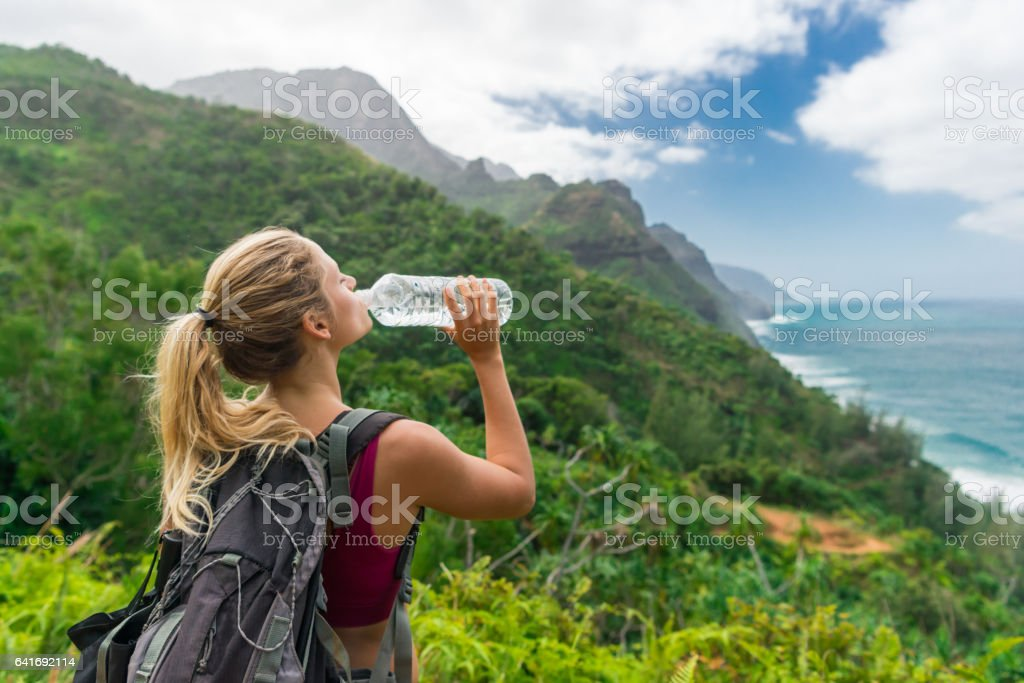 Hiker Drinking Water In The Beauty stock photo