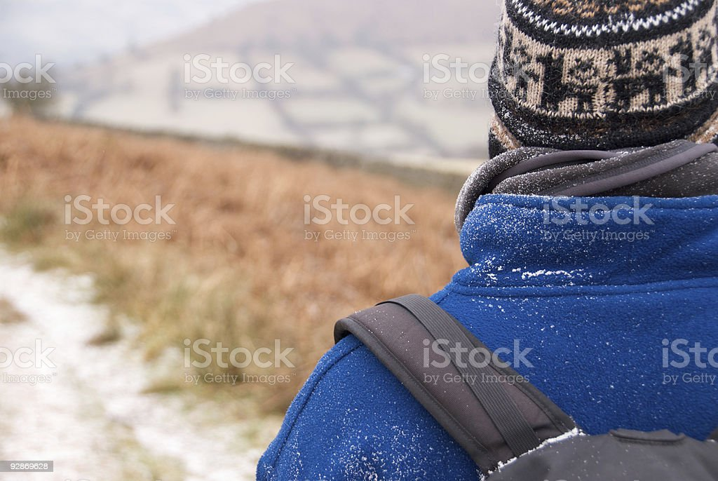 Hiker dusted with snowflakes royalty-free stock photo