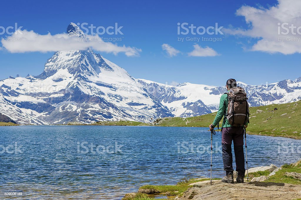 hiker enjoy summer day near the Matterhorn mountain stock photo