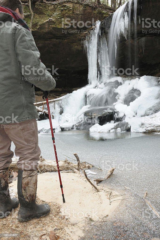 Hiker enjoying icefall royalty-free stock photo