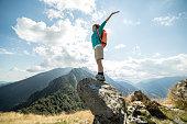 Hiker enjoying success at mountain top