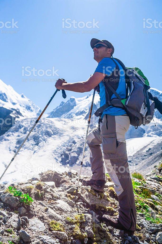 Hiker enjoying the mountain view. stock photo