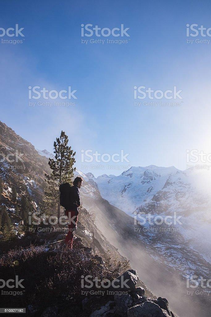 Hiker enjoying the mountain views on Morteratsch Glacier, Switzerland stock photo