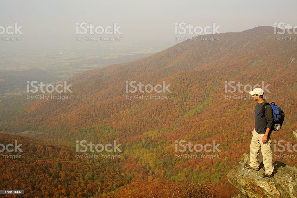 Hiker enjoying the view from Hawksbill Summit stock photo
