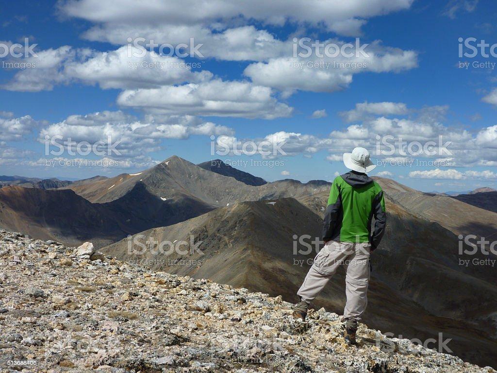 Hiker enjoys Grays Torreys Peaks view Rocky Mountains Colorado stock photo
