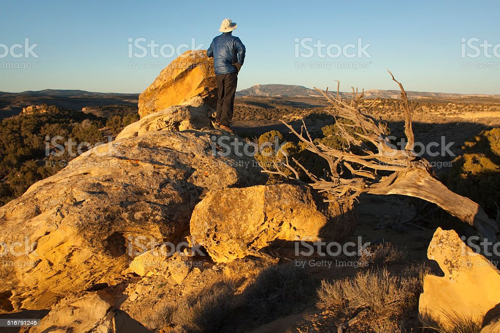Hiker enjoys sunset over Colorado's red rock Cathedral Bluffs stock photo