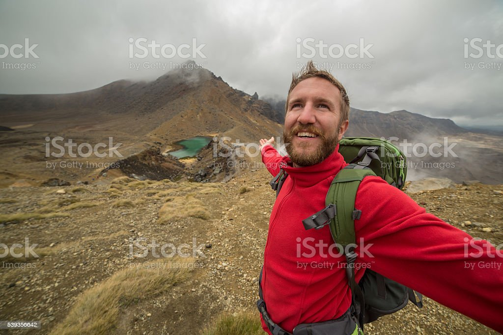 Hiker feeling great at mountain top stock photo