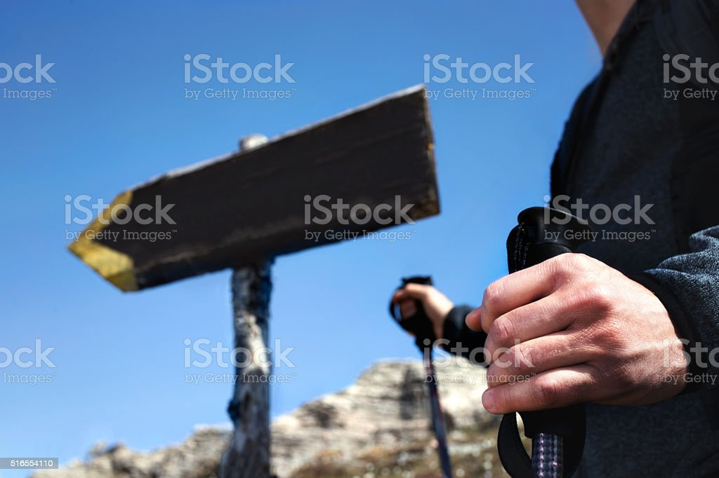 hiker follow the signs to reach the top of mountain stock photo