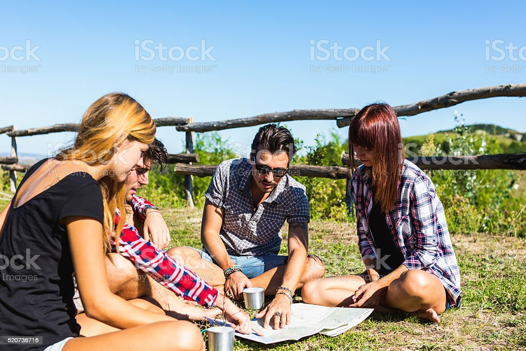 Hiker friends planning a route on a map stock photo