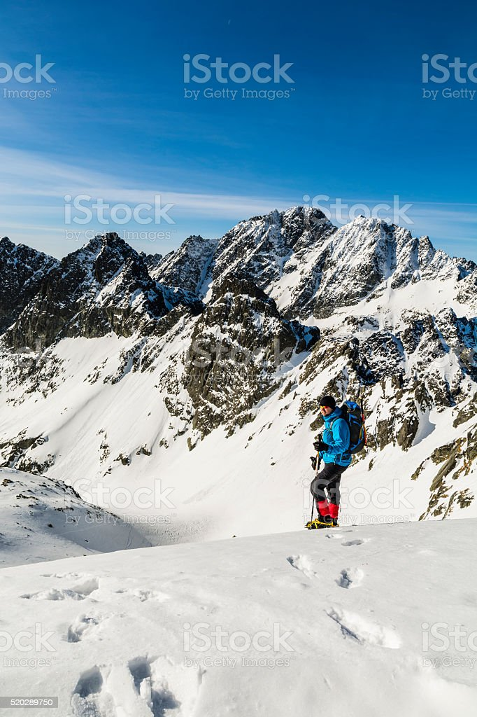 Hiker from Tatra ridge in the background. stock photo