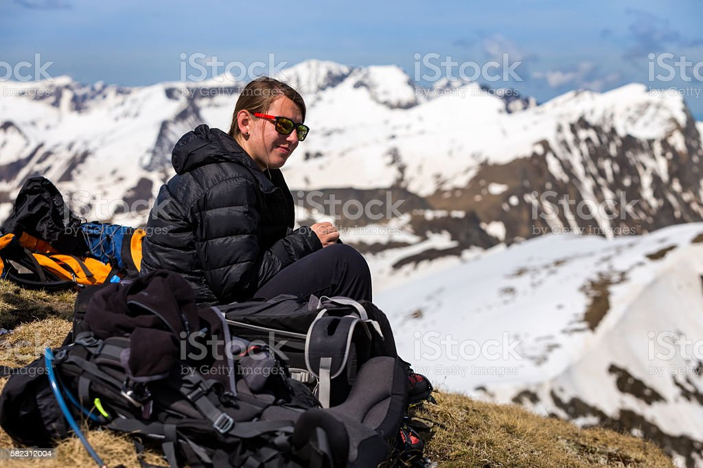 Hiker girl resting on the top of the Carpathian mountains. stock photo