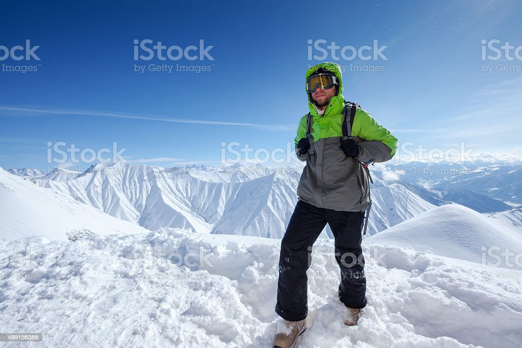 Hiker has fun in Caucasus winter mountains of Georgia stock photo