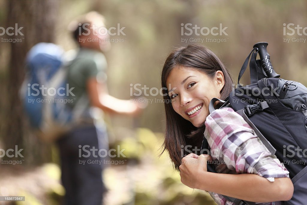 Hiker hiking in forest stock photo
