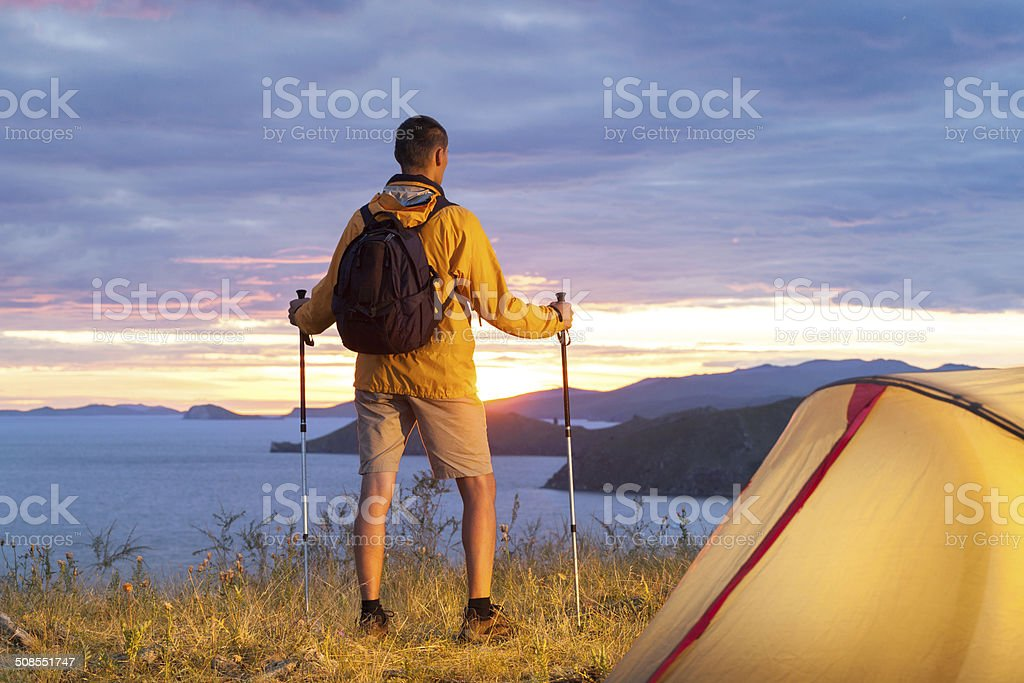 Hiker in a camp stock photo