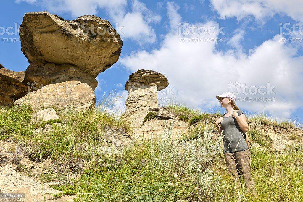 Hiker in badlands of Alberta, Canada stock photo