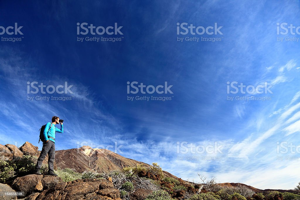 Hiker in dramatic landscape stock photo