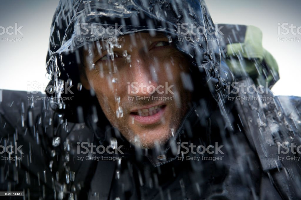 Hiker in Heavy Rain Storm stock photo
