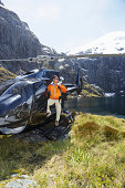 Hiker In Helicopter On Mountain Top