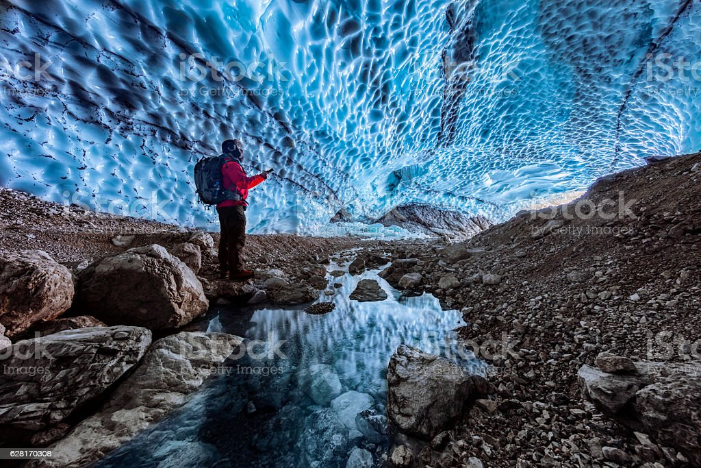 Hiker in ice cave,  Bavarian Alps - Berchtesgaden National Park stock photo