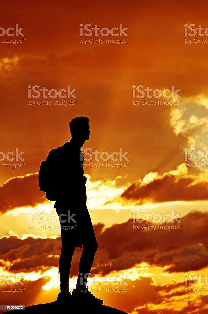Hiker in the dramatic sunset - V stock photo