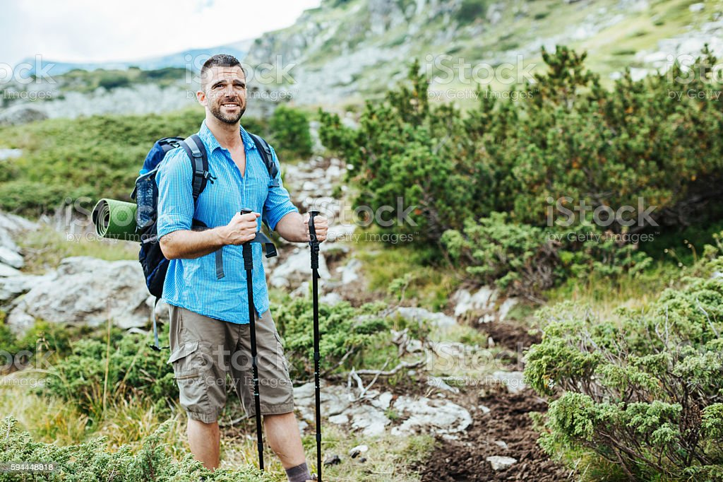 Hiker in the mountain stock photo
