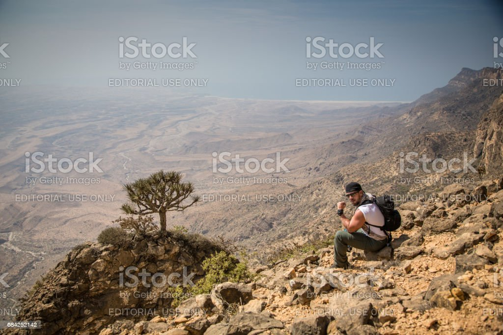 Hiker in the mountains in Oman stock photo