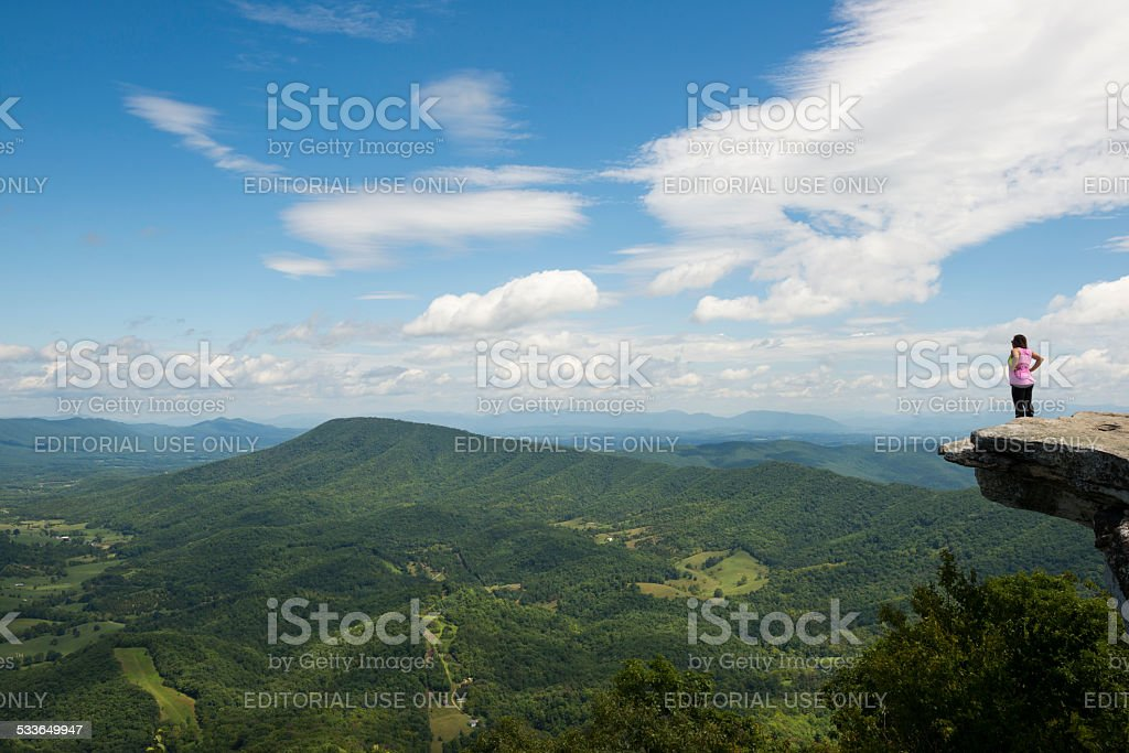 Hiker in Virginia enjoying the view from McAfee Knob stock photo