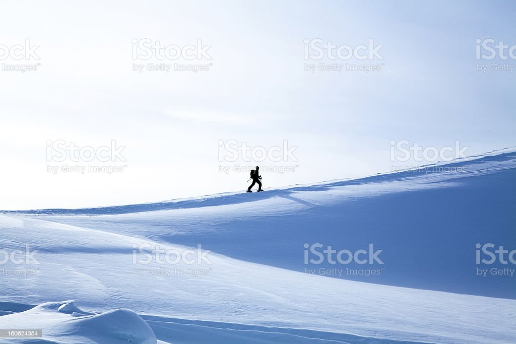 Hiker in winter mountains. royalty-free stock photo
