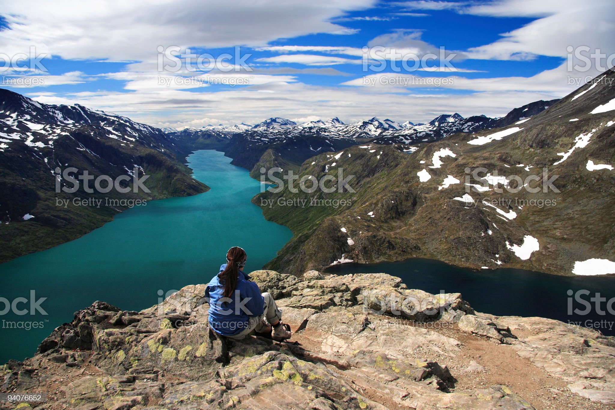 Hiker indulging in the vast mountain scenery royalty-free stock photo