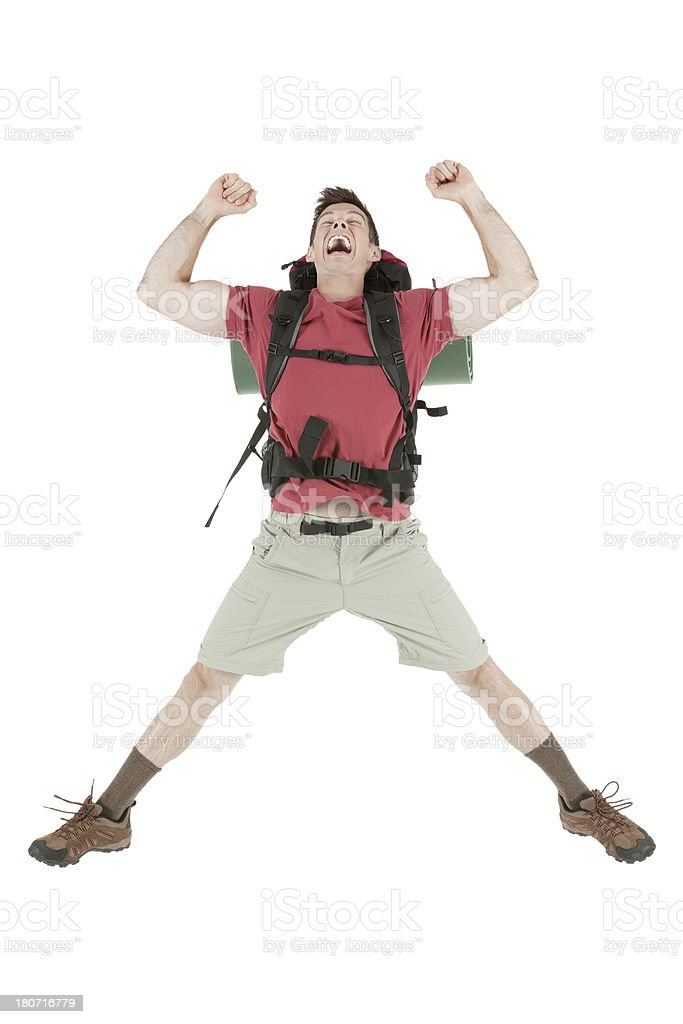 Hiker jumping in excitement royalty-free stock photo