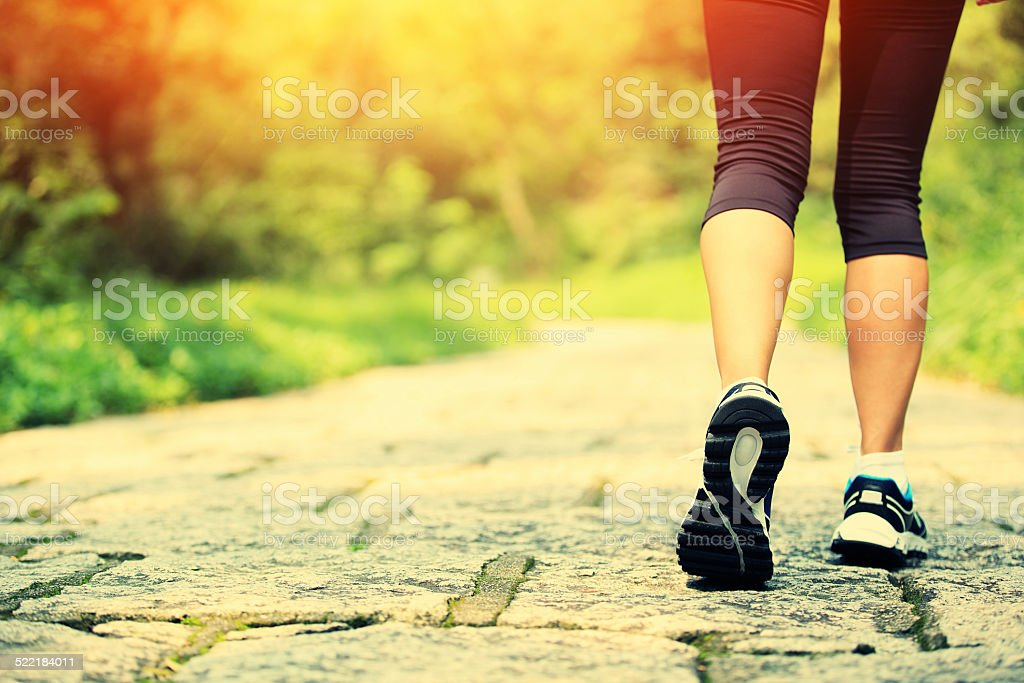 hiker legs hiking on stone trail stock photo