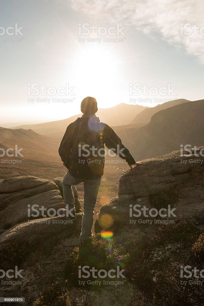 Hiker looking across Mourne Mountains, Northern Ireland stock photo