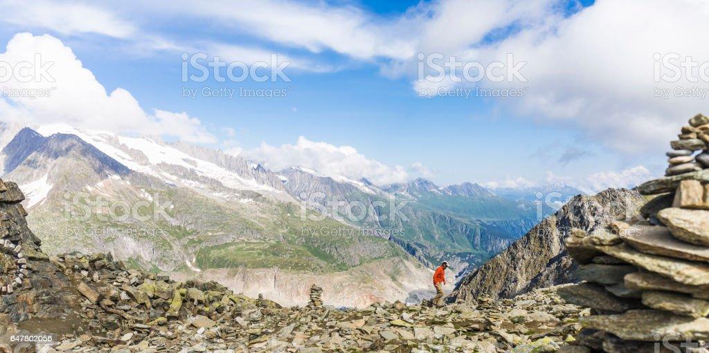 Hiker looking at mountain range stock photo