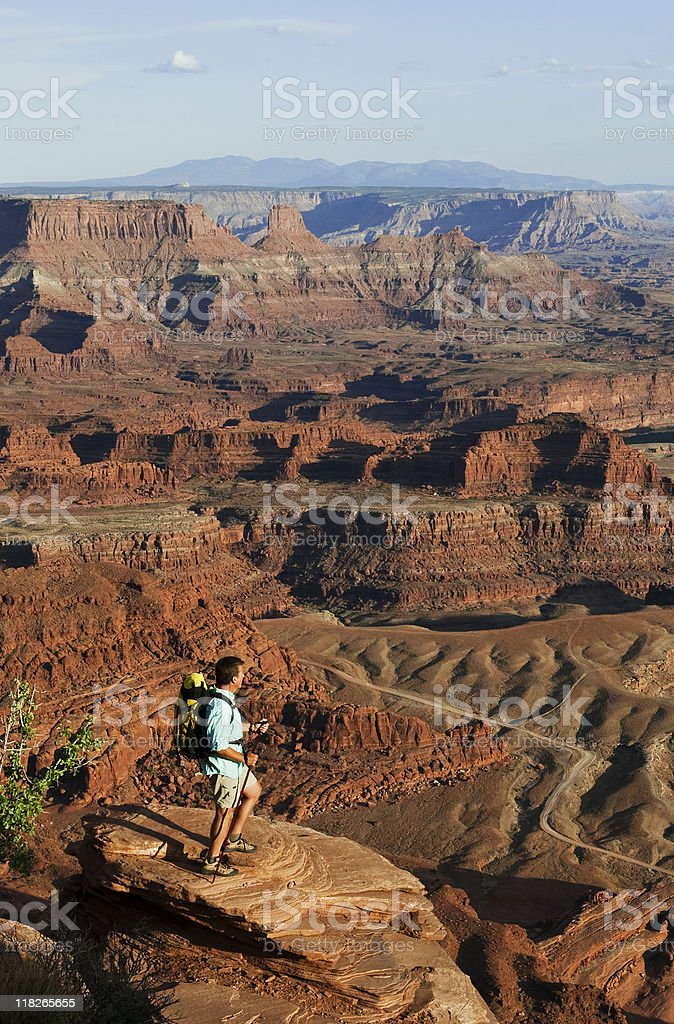 Hiker Looking At Panoramic View Of Canyons In Utah stock photo
