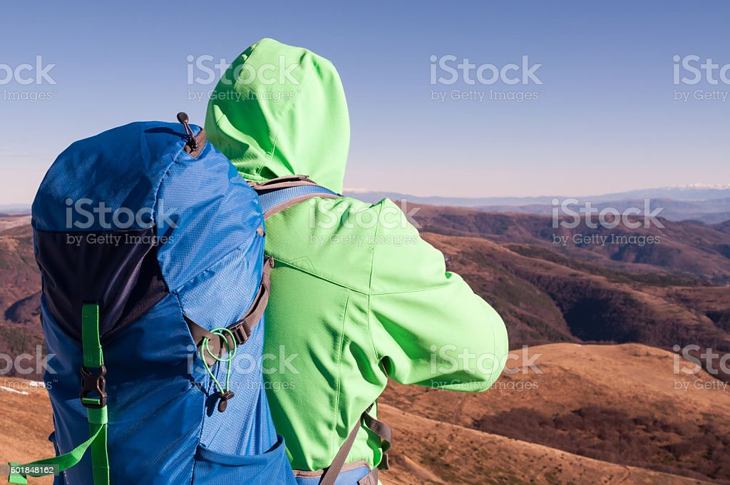 Hiker looking at the mountain scenery stock photo